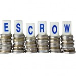 Stacks of coins with the word ESCROW isolated on white background